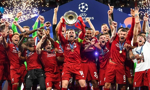 Liverpool celebrating their Champions League trophy